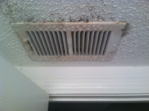 Faulty A/C system causing condensation and mold around vents.
